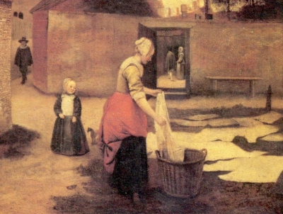 laying white laundry on grass in town of Delft