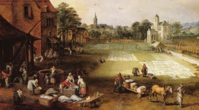 women washing and laundry on field beside town