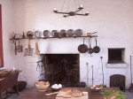 kitchen fireplace with hanging gridirons, skillets etc.
