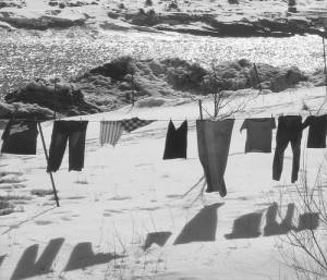 clothes on washing-line and shadows against snowy landscape