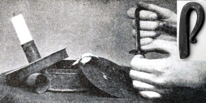old photo showing hand with firesteel