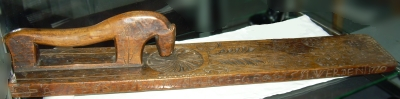 board with carved decoration and horse-shaped handle