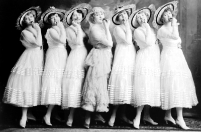 chorus line on stage in white muslin