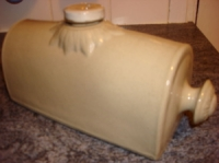 pottery hot water bottle with stopper and carrying handle