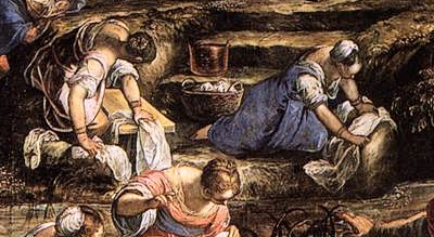 kneeling women scrubbing cloth on rock and board