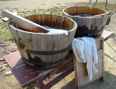 Wooden tubs with rope handles on bench