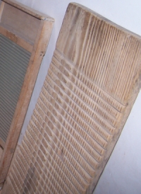 Wooden washboard, apparently hand-carved grooves